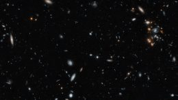 An image of a galaxy cluster taken by the NASA/ESA Hubble Space Telescope